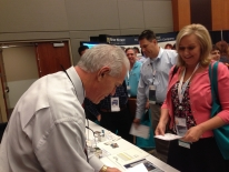 Bob Davies Signing Books at the Right At Home Franchise convention